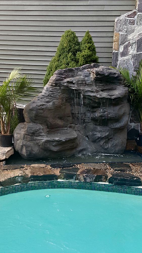 Large Vertical Waterfalls used for a Swimming Pool by Andrea T