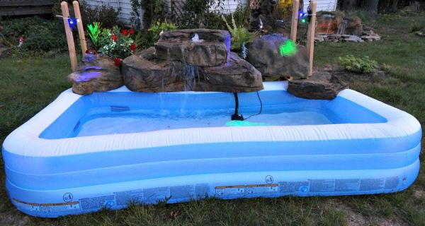 Swimming Pools With Waterfalls artificial rock waterfalls for above ground swimming pools